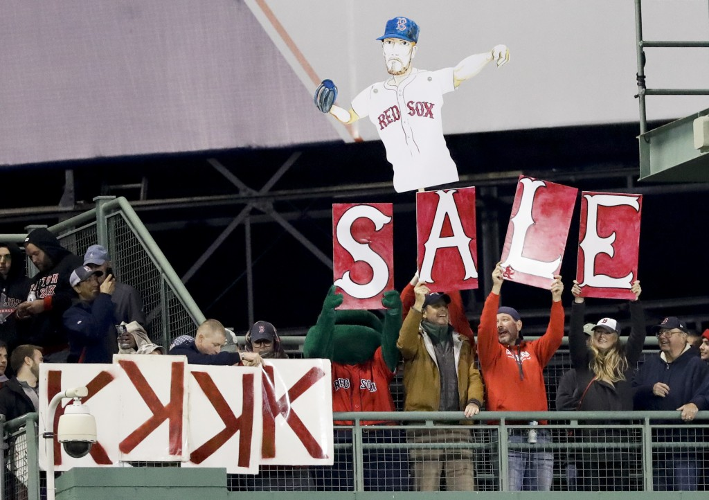 Fans cheer for Boston Red Sox starting pitcher Chris Sale during the fourth inning in Game 1 of a baseball American League Championship Series against