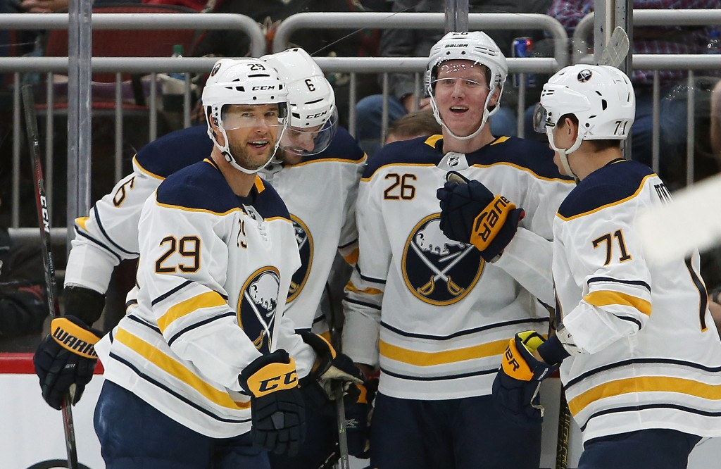 Buffalo Sabres defenseman Rasmus Dahlin (26) celebrates with Jason Pominville (29), Marco Scandella (6) and Evan Rodrigues (71) after scoring in the f