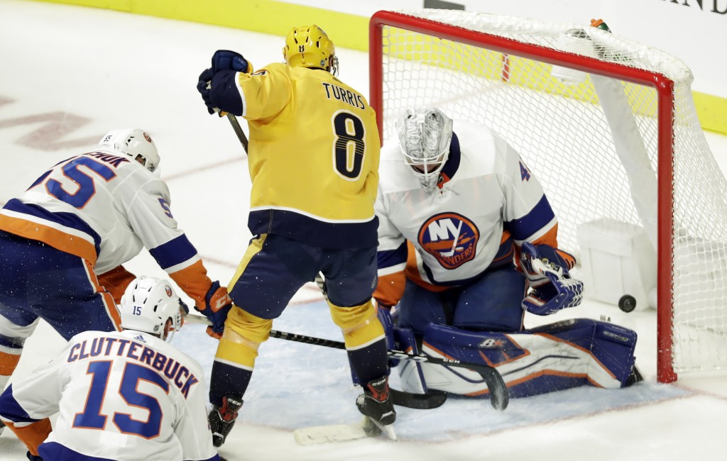 Nashville Predators center Kyle Turris (8) scores a goal against New York Islanders goaltender Robin Lehner (40), of Sweden, during the third period o
