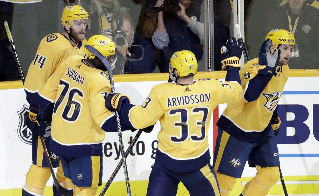 Nashville Predators left wing Filip Forsberg (9), of Sweden, is congratulated by Viktor Arvidsson (33), P.K. Subban (76) and Mattias Ekholm (14) after