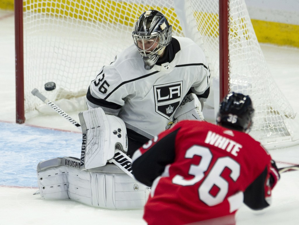 Ottawa Senators centre Colin White fires (36) the puck past Los Angeles Kings goaltender Jack Campbell (36) to score during second period NHL hockey a