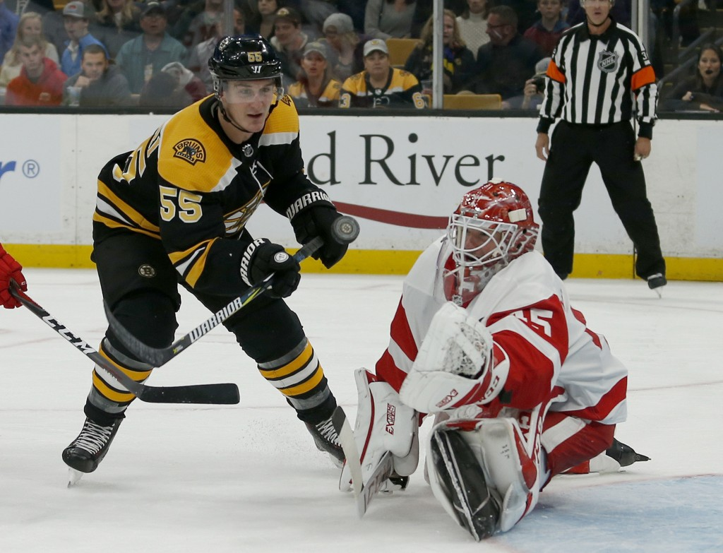 Boston Bruins center Noel Acciari (55) tries to score as Detroit Red Wings goaltender Jonathan Bernier (45) makes a save during the second period of a