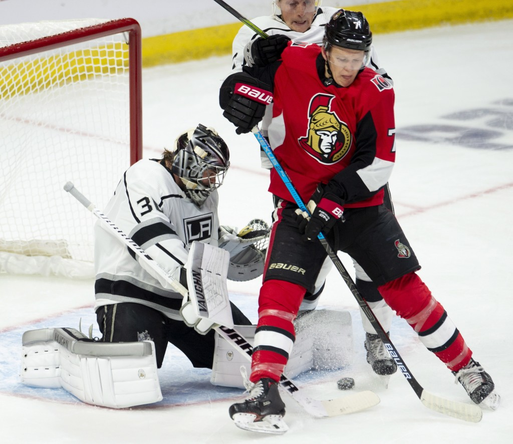 Ottawa Senators left wing Brady Tkachuk (7) tries to deflect a puck past Los Angeles Kings goaltender Jack Campbell (36) as he is pressured by defense