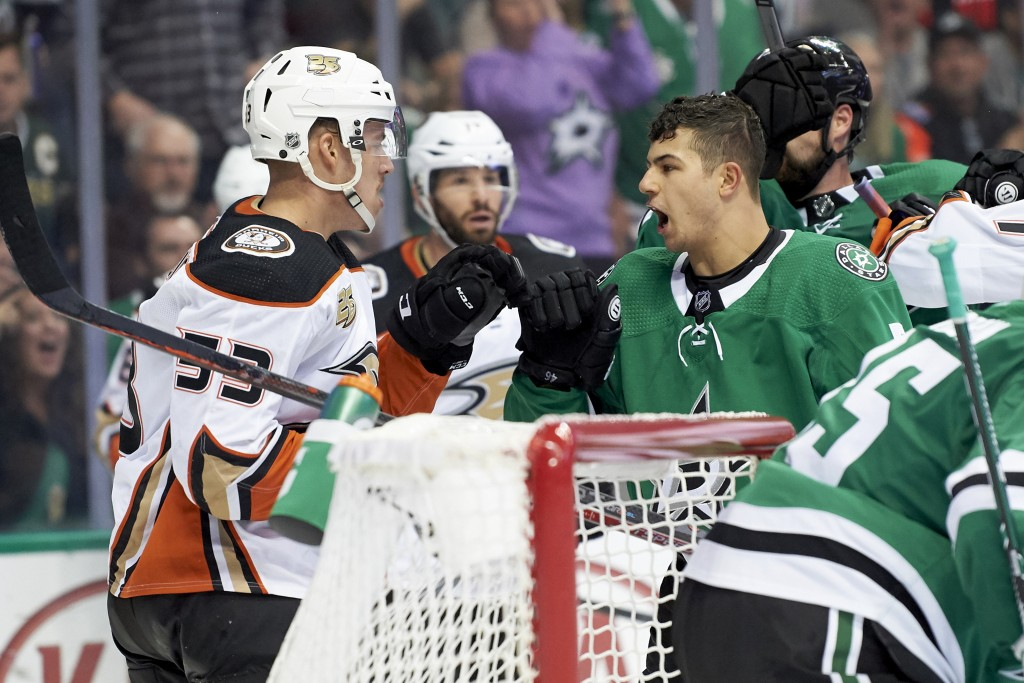 Dallas Stars defenseman Connor Carrick (5) has words with Anaheim Ducks left wing Max Comtois (53) during the second period of an NHL hockey game Satu