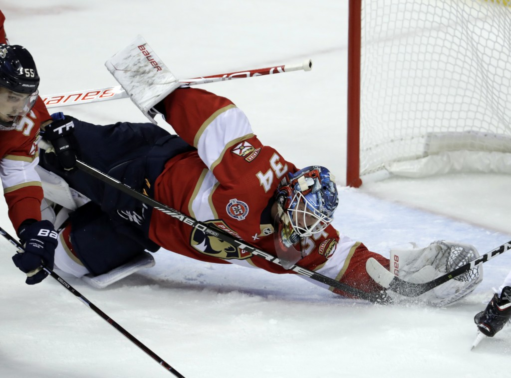 Florida Panthers goaltender James Reimer dives to make a save during the first period of an NHL hockey game against the Vancouver Canucks, Saturday, O