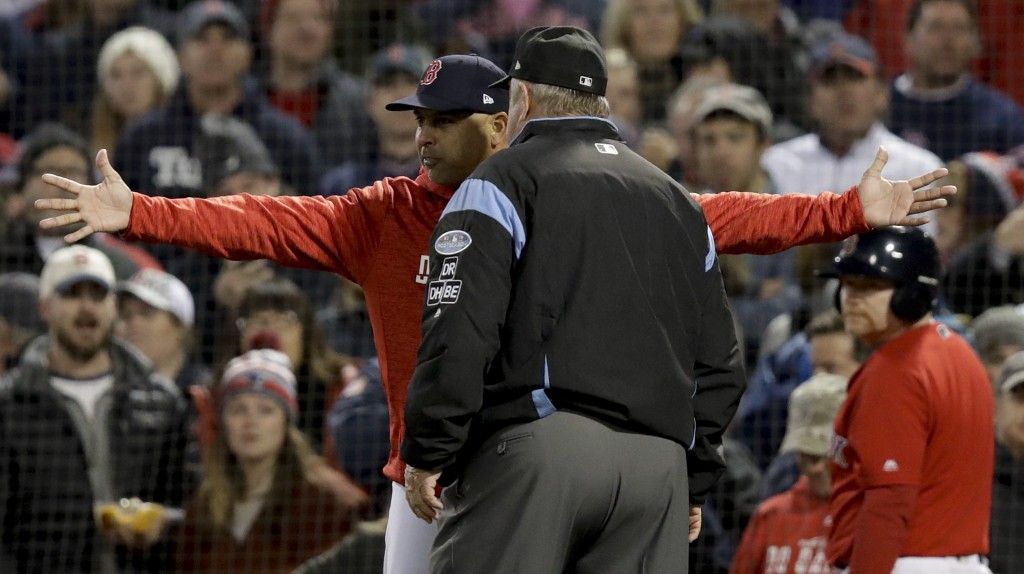 Boston Red Sox manager Alex Cora argues a strike three call with umpire Joe West during the fifth inning in Game 1 of a baseball American League Champ