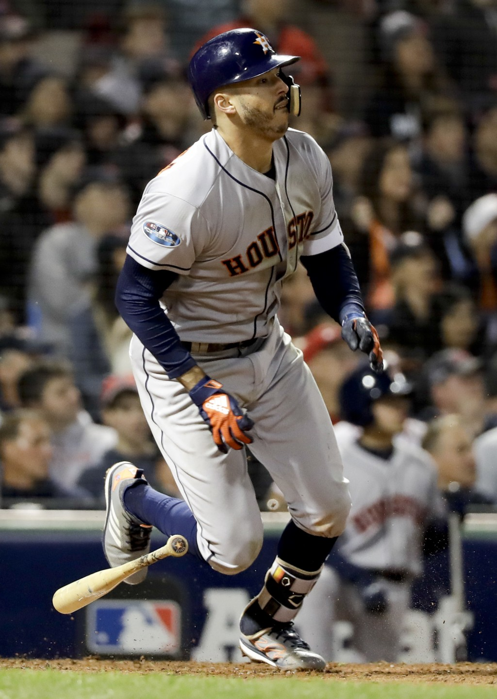 Houston Astros' Carlos Correa watch his RBI-single against the Boston Red Sox during the sixth inning in Game 1 of a baseball American League Champion