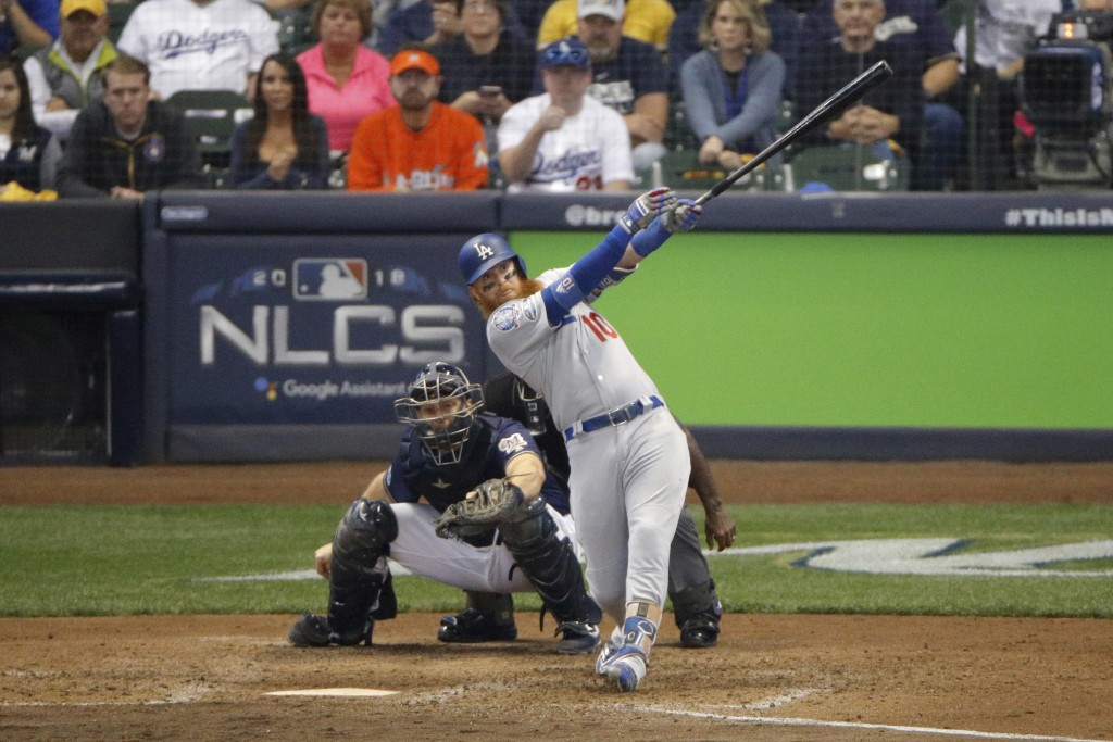 Los Angeles Dodgers' Justin Turner (10) hits a two-run home run during the eighth inning of Game 2 of the National League Championship Series baseball
