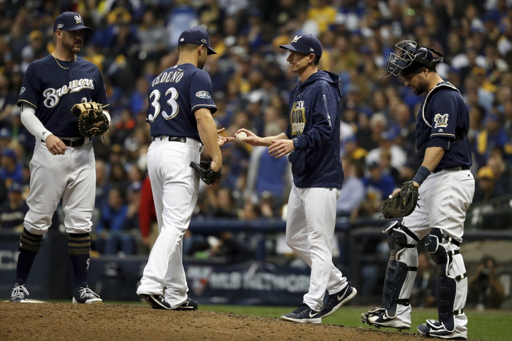 Milwaukee Brewers manager Craig Counsell removes relief pitcher Xavier Cedeno (33) during the ninth inning of Game 2 of the National League Championsh