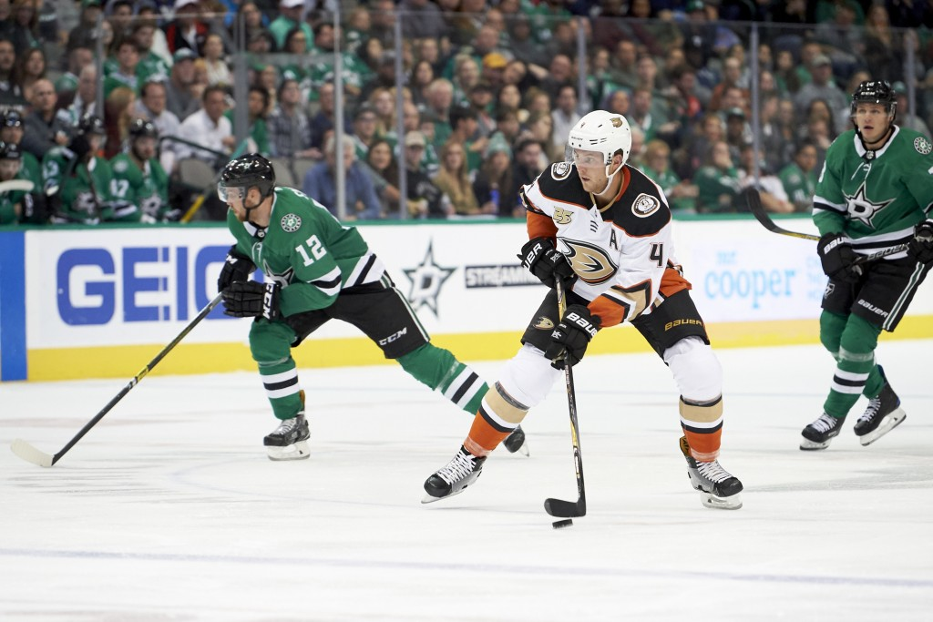 Anaheim Ducks defenseman Cam Fowler (4) controls the puck against the Dallas Stars during the second period of an NHL hockey game Saturday, Oct. 13, 2