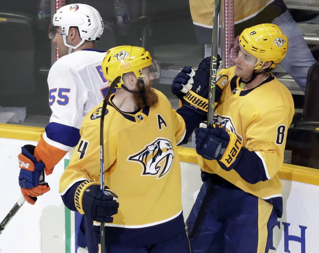 Nashville Predators center Kyle Turris (8) is congratulated by Ryan Ellis (4) after Turris scored a goal against the New York Islanders in the third p