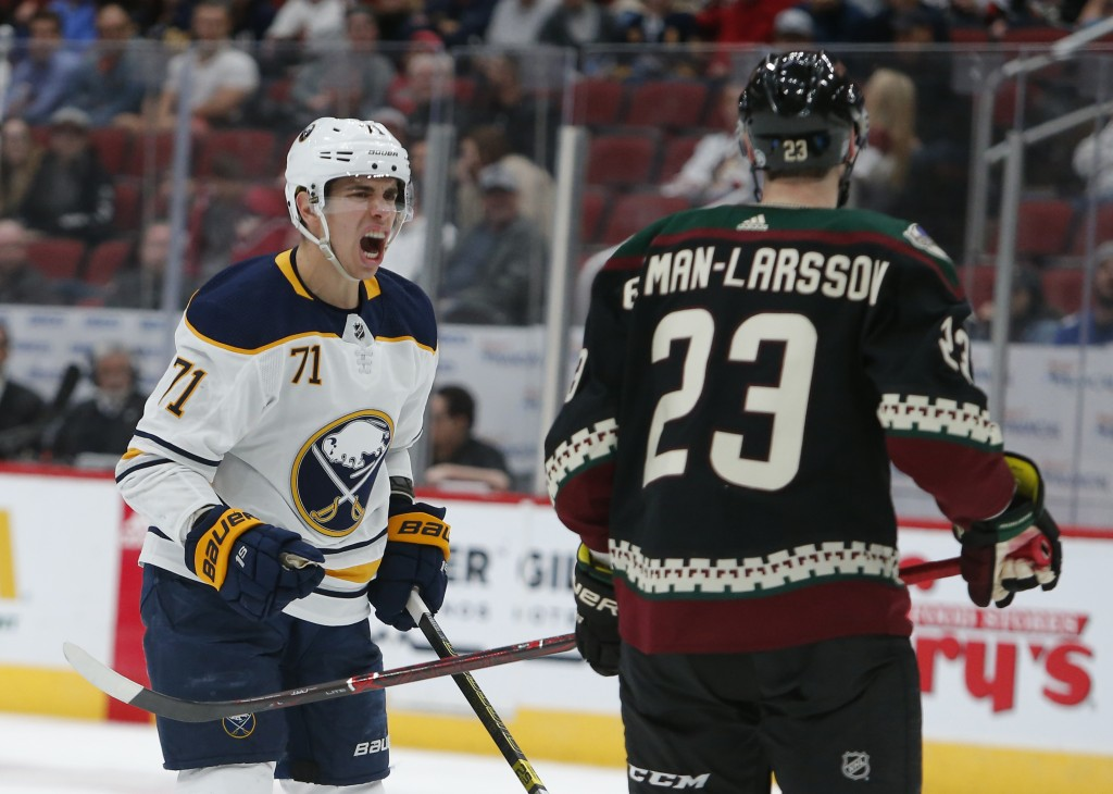 Buffalo Sabres left wing Evan Rodrigues (71) yells at Arizona Coyotes defenseman Oliver Ekman-Larsson after getting slashed during the third period du