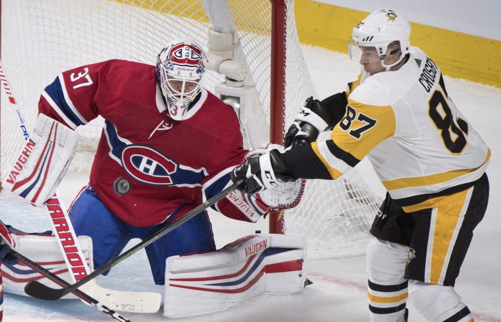 Pittsburgh Penguins' Sidney Crosby moves in on Montreal Canadiens goaltender Antti Niemi during the third period of an NHL hockey game, Saturday, Oct.