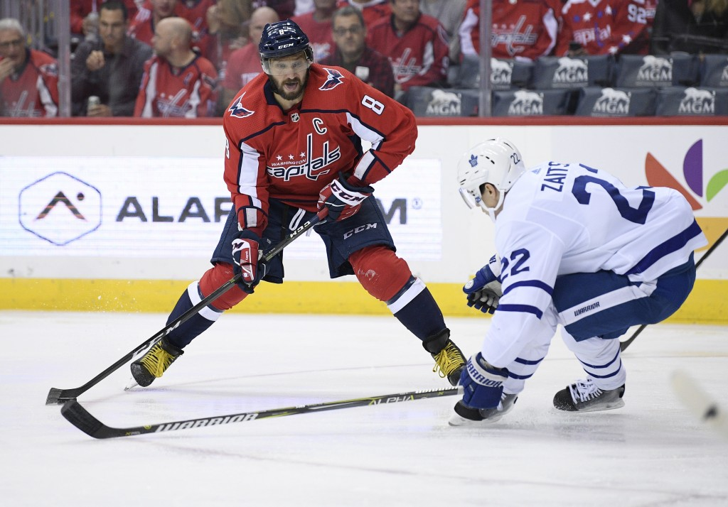Washington Capitals left wing Alex Ovechkin (8), of Russia, skates with the puck against Toronto Maple Leafs defenseman Nikita Zaitsev (22), of Russia