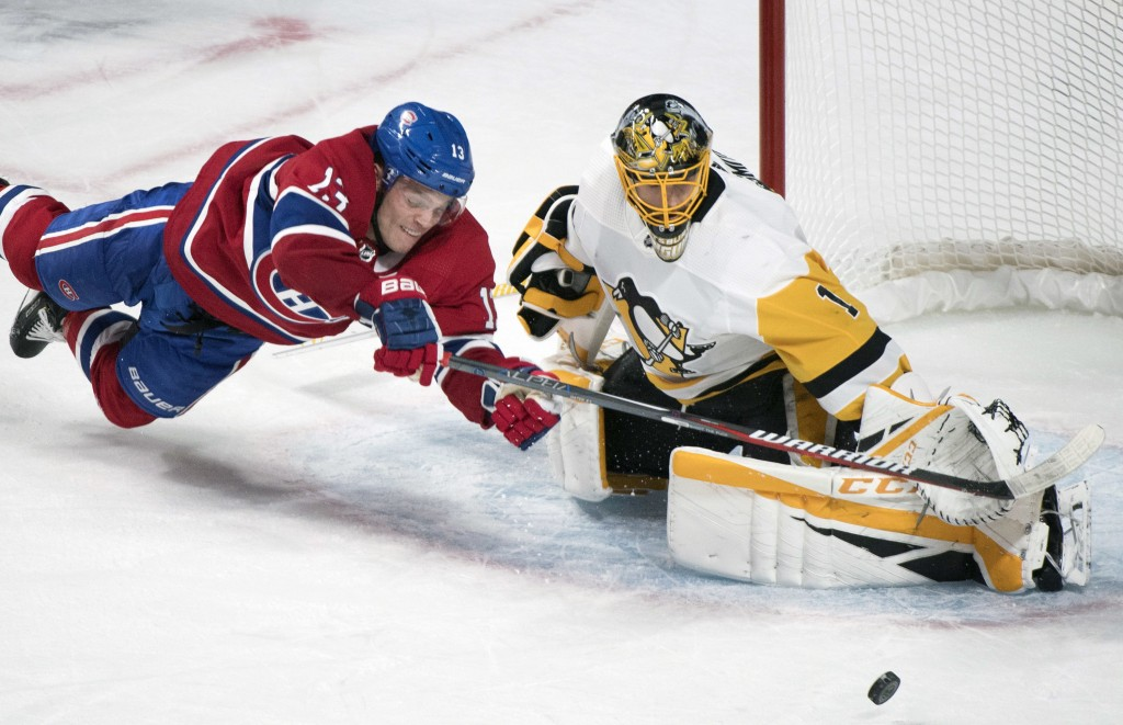 Pittsburgh Penguins goaltender Casey DeSmith makes a save against Montreal Canadiens' Max Domi during the overtime period of an NHL hockey game, Satur