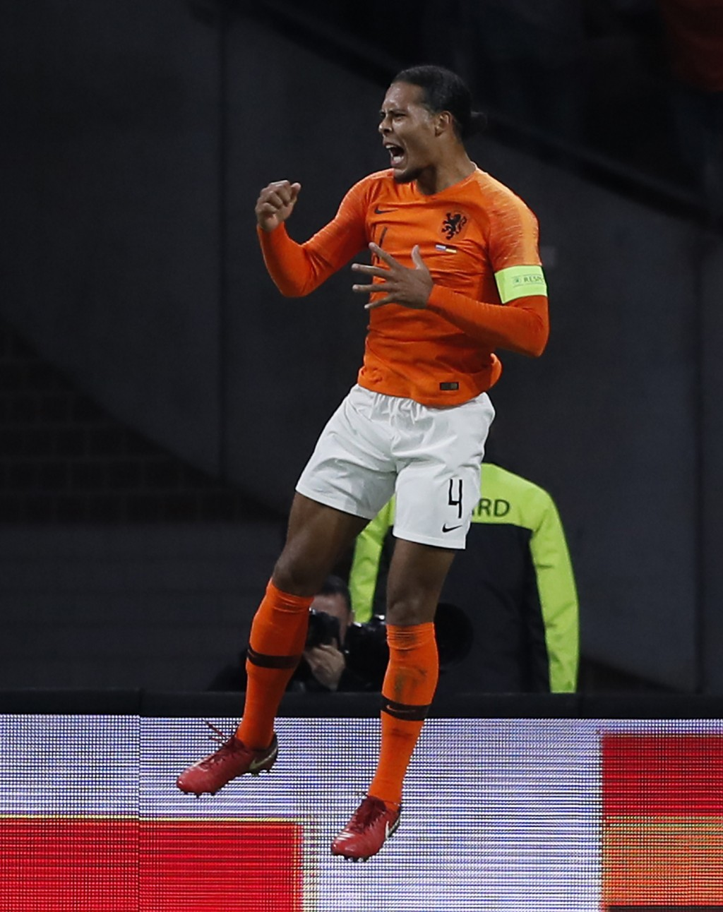 Netherland's Virgil Van Dijk celebrates after scoring the opening goal during the UEFA Nations League soccer match between The Netherlands and Germany