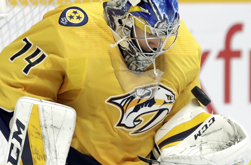 Nashville Predators goaltender Juuse Saros, of Finland, blocks a shot by the New York Islanders during the first period of an NHL hockey game Saturday