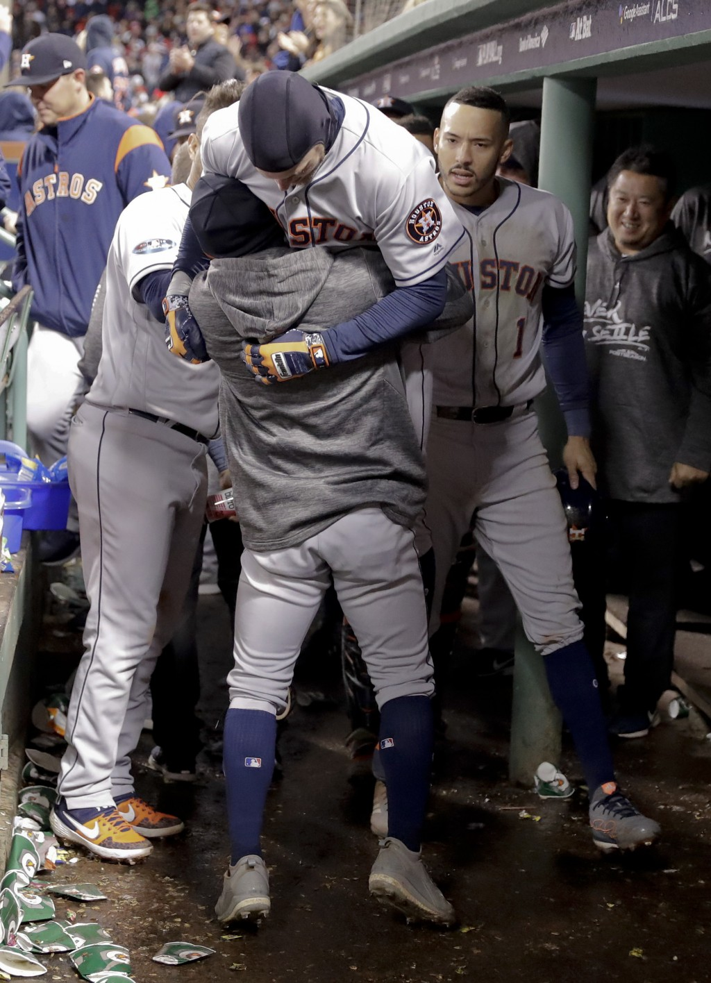 Houston Astros' Josh Reddick celebrates in the dugout after a home run during the ninth inning in Game 1 of a baseball American League Championship Se