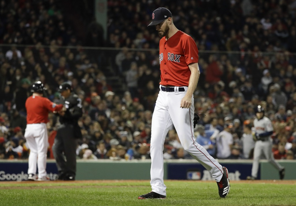 Boston Red Sox starting pitcher Chris Sale walks to the dugout after giving up two runs against the Houston Astros during the second inning in Game 1