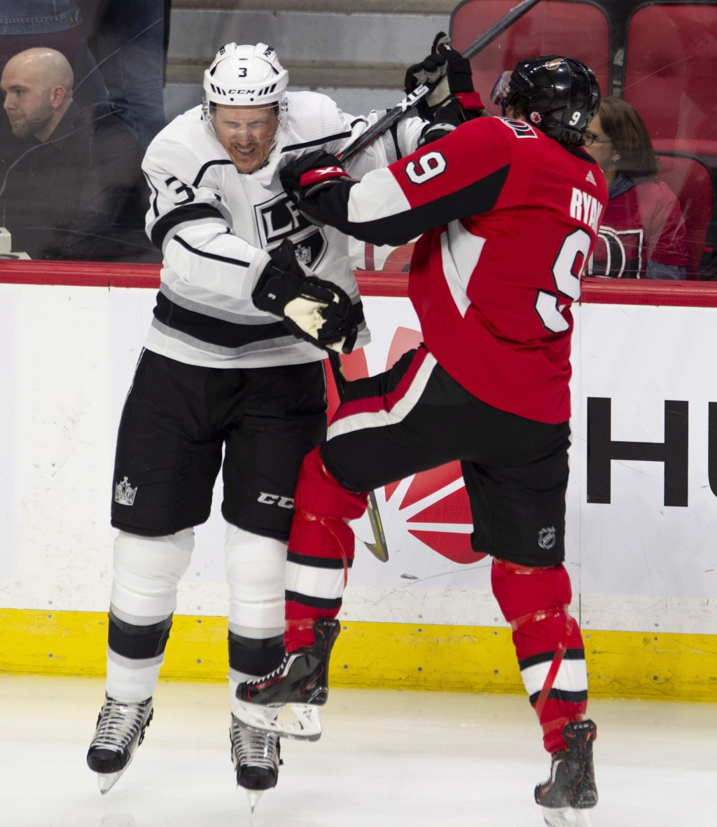 Former teammates Ottawa Senators right wing Bobby Ryan (9) and Los Angeles Kings defenceman Dion Phaneuf (3) collides during first period NHL hockey a