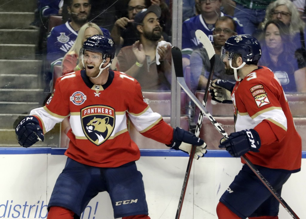 Florida Panthers left wing Jonathan Huberdeau, left, celebrates with Keith Yandle (3) after scoring a goal during the second period of an NHL hockey g