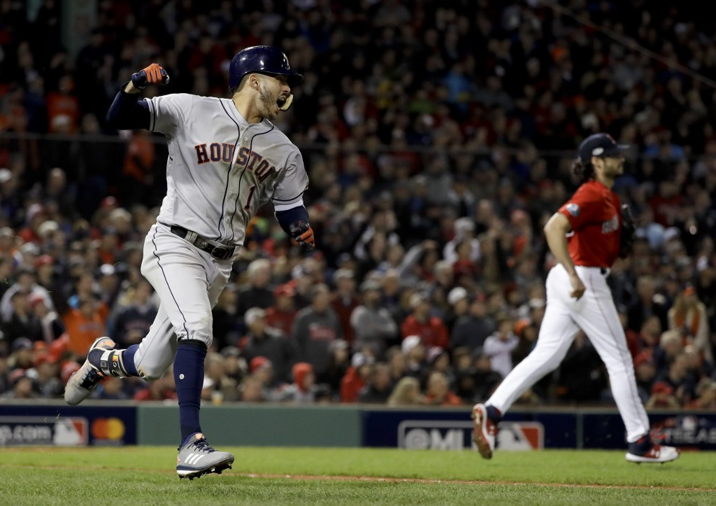 Houston Astros' Carlos Correa celebrates after his RBI-single against the Boston Red Sox during the sixth inning in Game 1 of a baseball American Leag