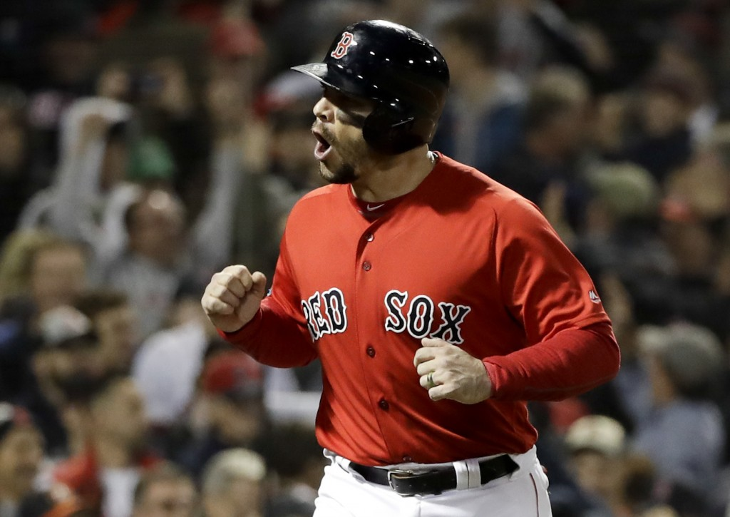 Boston Red Sox's Steve Pearce celebrates after being walked in for a run during the fifth inning in Game 1 of a baseball American League Championship