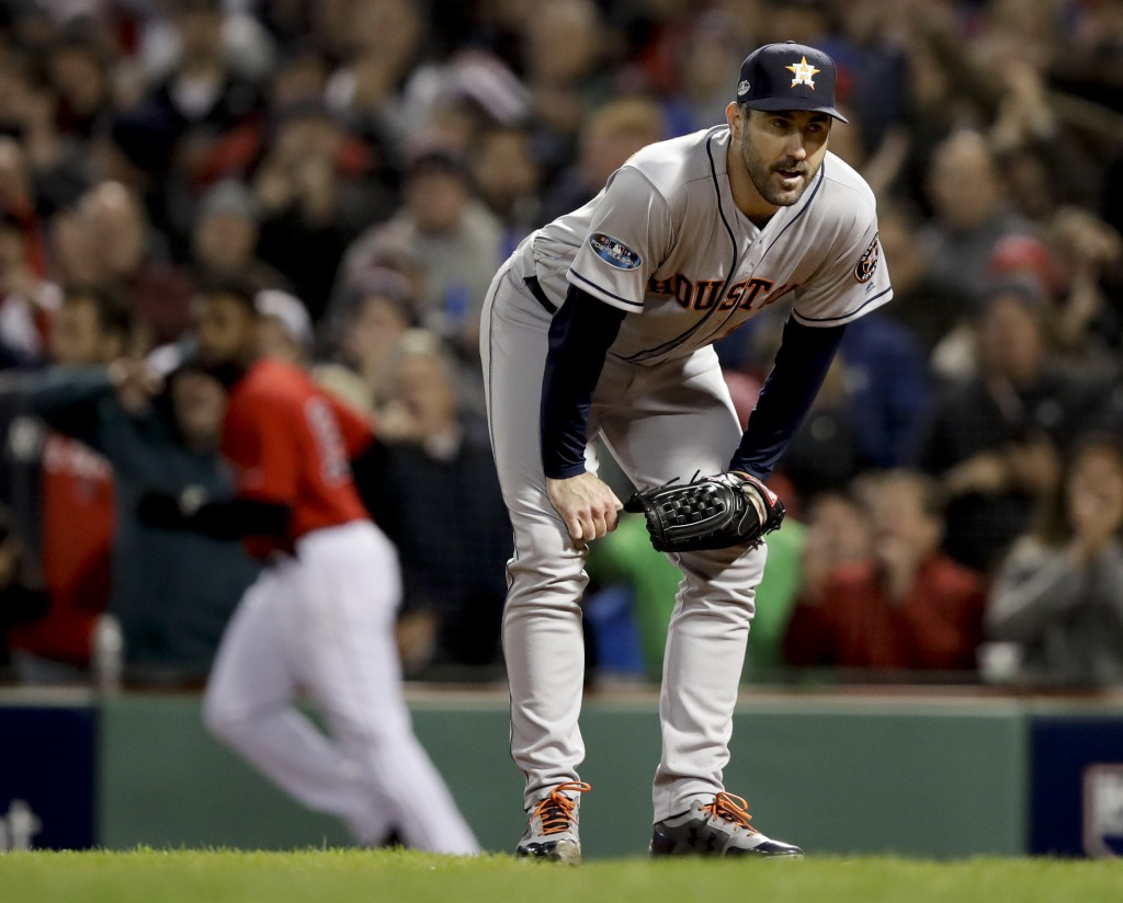 Houston Astros starting pitcher Justin Verlander reacts after Boston Red Sox's Jackie Bradley Jr. scored on a wild pitch during the fifth inning in Ga