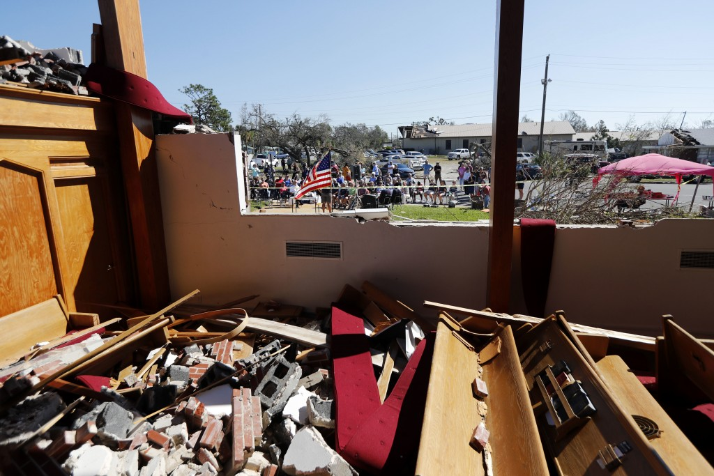A Sunday service is held outside the damaged St. Andrew United Methodist Church, in the aftermath of Hurricane Michael in Panama City, Fla., Sunday, O...