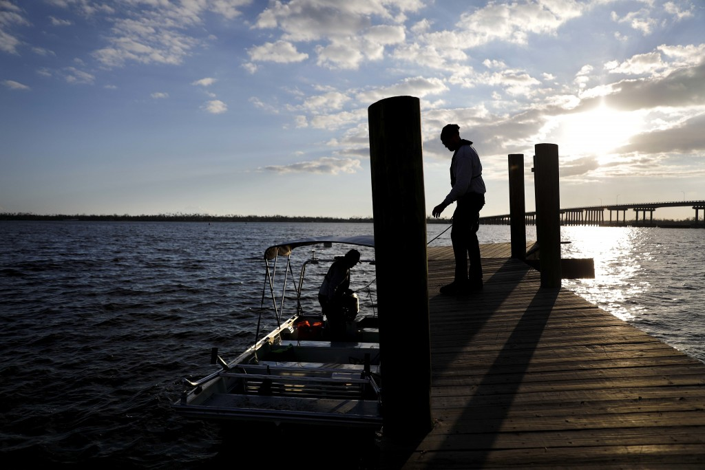 Members of a South Florida urban search and rescue team return from searching a remote area of Mexico Beach for survivors of hurricane Michael, Sunday...