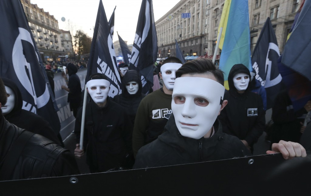 Members of the nationalist movements attend a rally marking Fatherland Defender Day in centre Kiev, Ukraine, Sunday, Oct. 14, 2018. (AP Photo/Efrem Lu