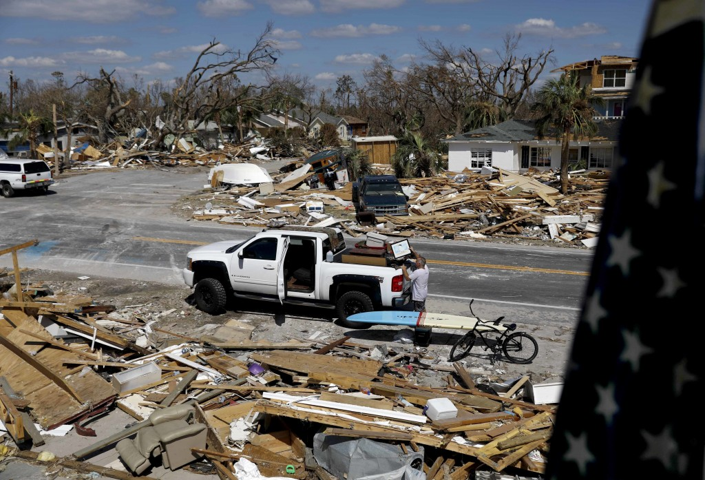 William Johnson helps pack up a friend's belongings as he returns to his damaged home from hurricane Michael in Mexico Beach, Fla., Sunday, Oct. 14, 2...
