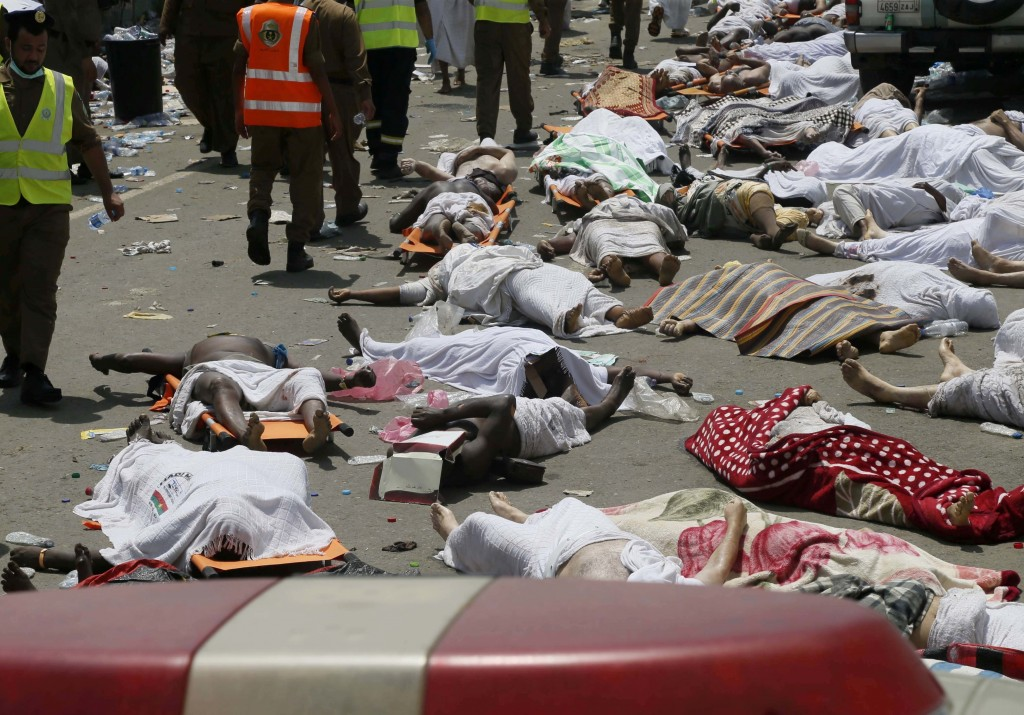 FILE - In this Sept. 24, 2015, file photo, bodies of people who died in a crush in Mina, Saudi Arabia during the annual hajj pilgrimage lie in a stree