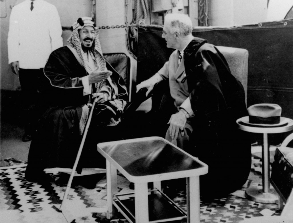 FILE - In this Feb. 14, 1945 file photo, U.S. President Franklin D. Roosevelt, right, and King Abdul Aziz Ibn Saud discuss Saudi-U.S. relations aboard