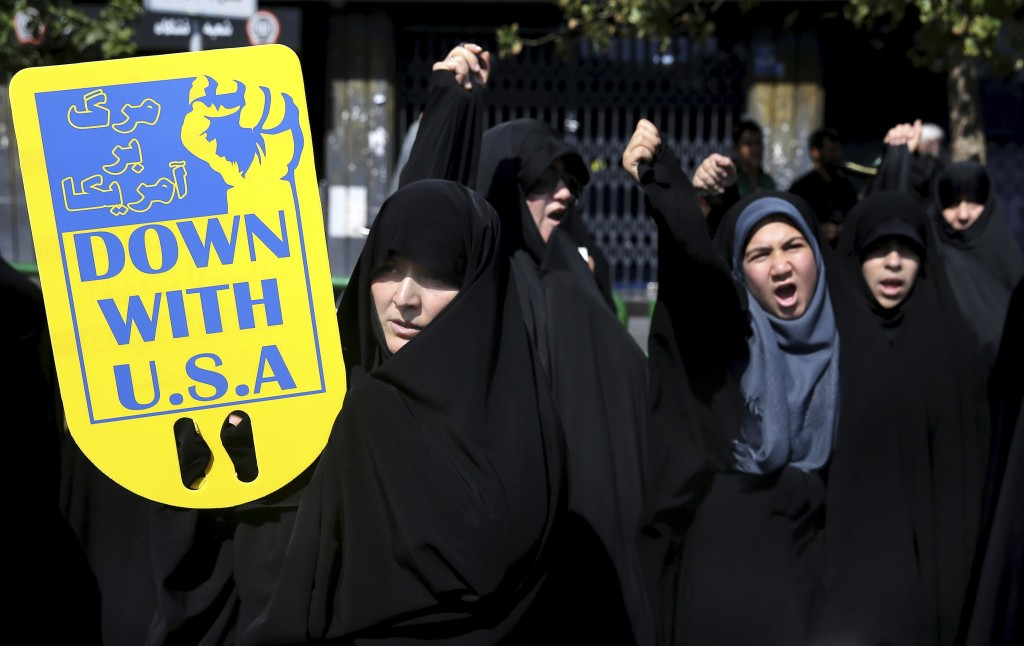 FILE - In this Sept. 28, 2018 file photo, worshippers chant slogans against America, Israel and Saudi Arabia, at a rally to condemn a terror attack in