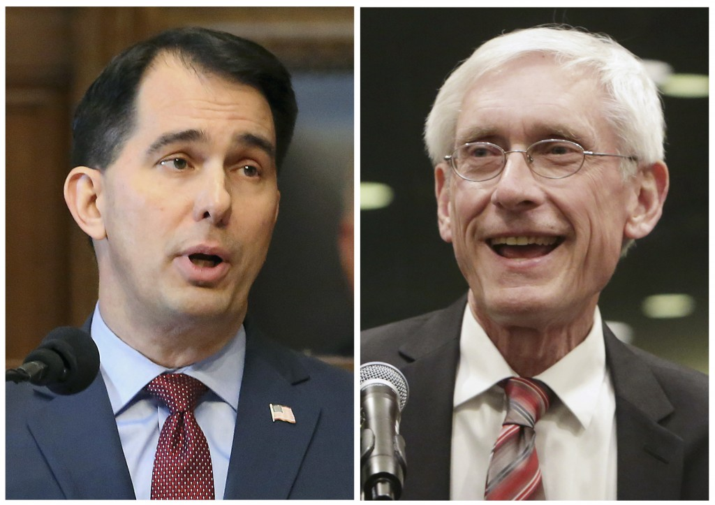 FILE - This combination of file photos shows Wisconsin Republican Gov. Scott Walker, left, and his Democratic challenger Tony Evers in the 2018 Novemb