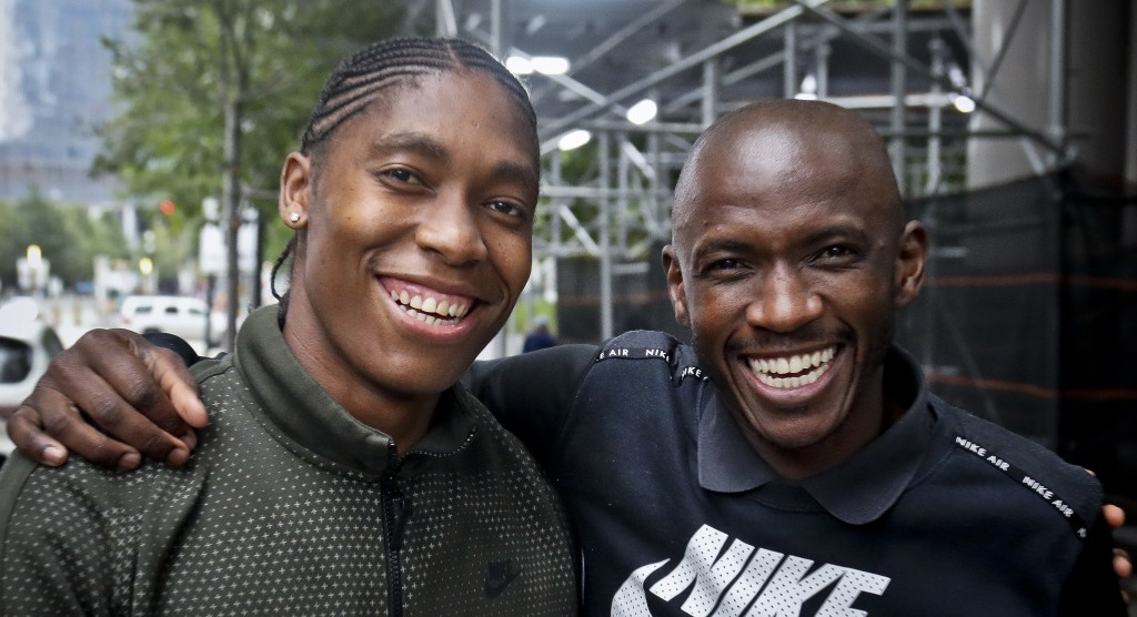 Caster Semenya, left, the current 800-meter Olympic gold and world champion from South Africa, with her coach Samuel Sepeng, right, during their visit...
