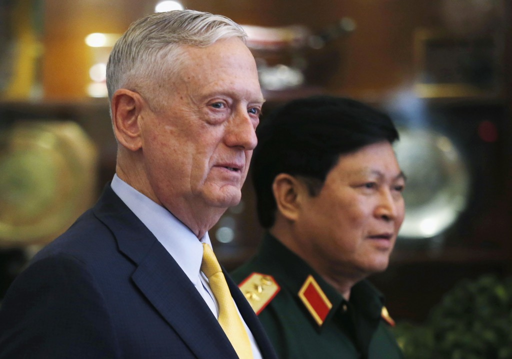 U.S. Secretary of Defense Jim Mattis, left, and Vietnam's Defense Minister Gen. Ngo Xuan Lich leave a meeting room in Ho Chi Minh City, Vietnam, Wedne...