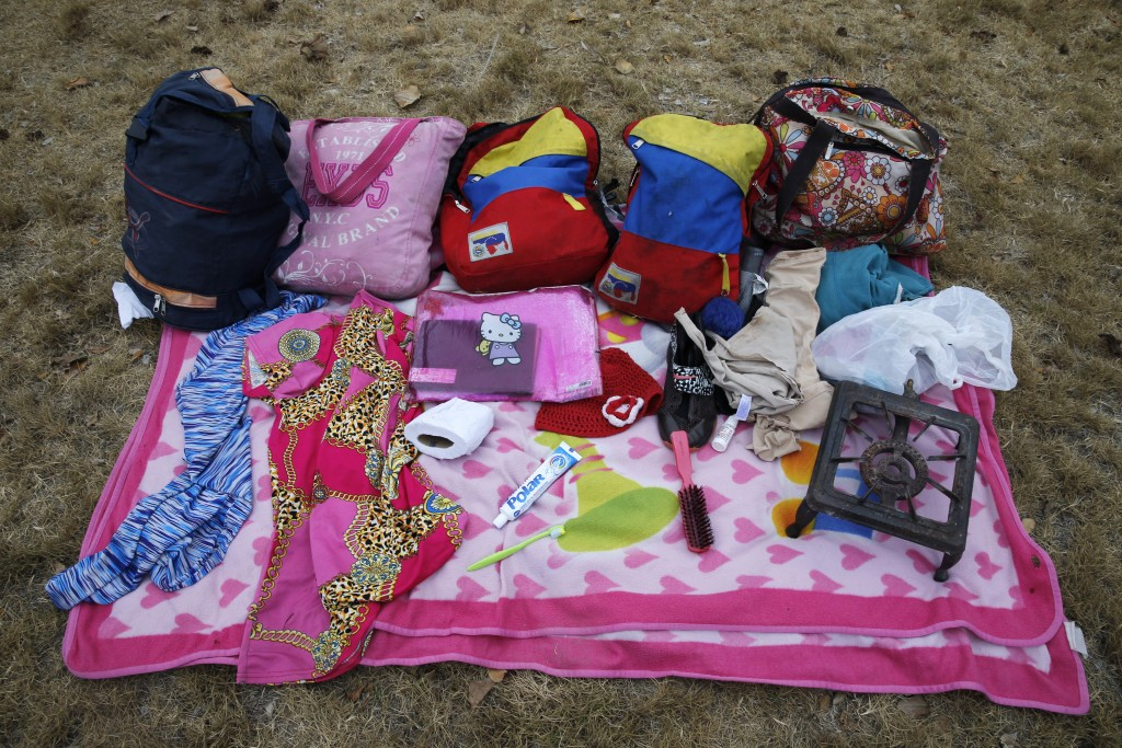 In this Sept. 7, 2018 photo, the belongings of Venezuelan mother Sandra Cadiz and her 10-year-old daughter Angelis, which they carried by foot on thei
