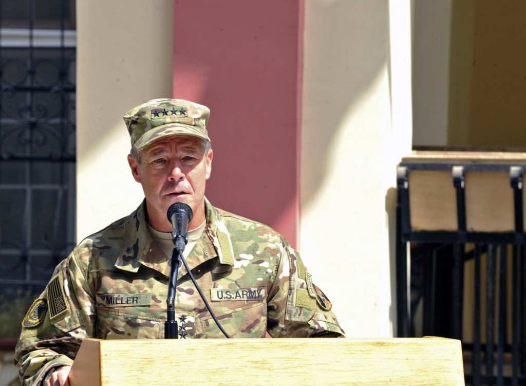 In this September 2, 2018 photo, provided by the U.S. Air Force, U.S. Army Gen. Scott Miller, commander of U.S. and NATO troops in Afghanistan, delive...