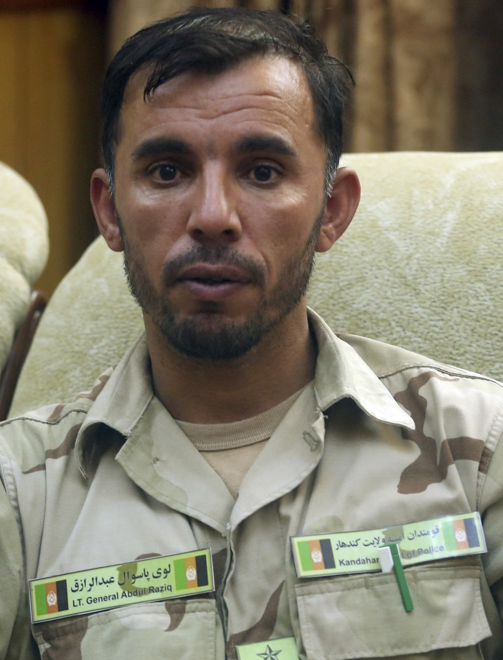 In this Aug. 4, 2016 photo, Gen. Abdul Raziq, Kandahar police chief, speaks during an interview with The Associated Press in Kandahar, Afghanistan. Th...