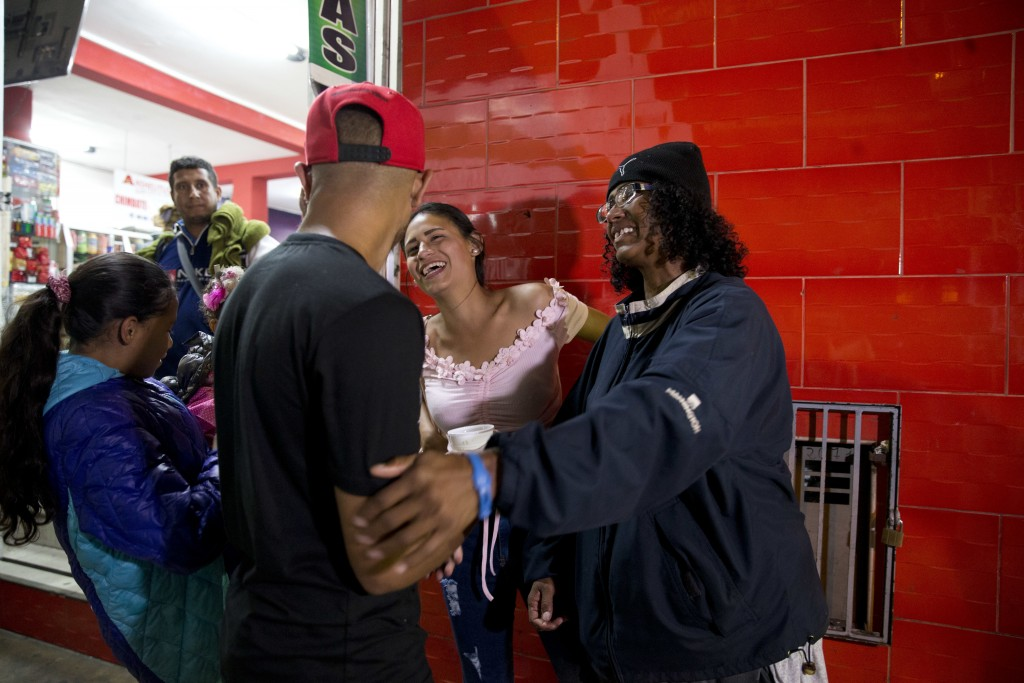 In this Sept. 8, 2018 photo, Sandra Cadiz, right, reunites with her son Leonardo, front left, and her daughter-in-law Daniela Gomez, as she and her 10...