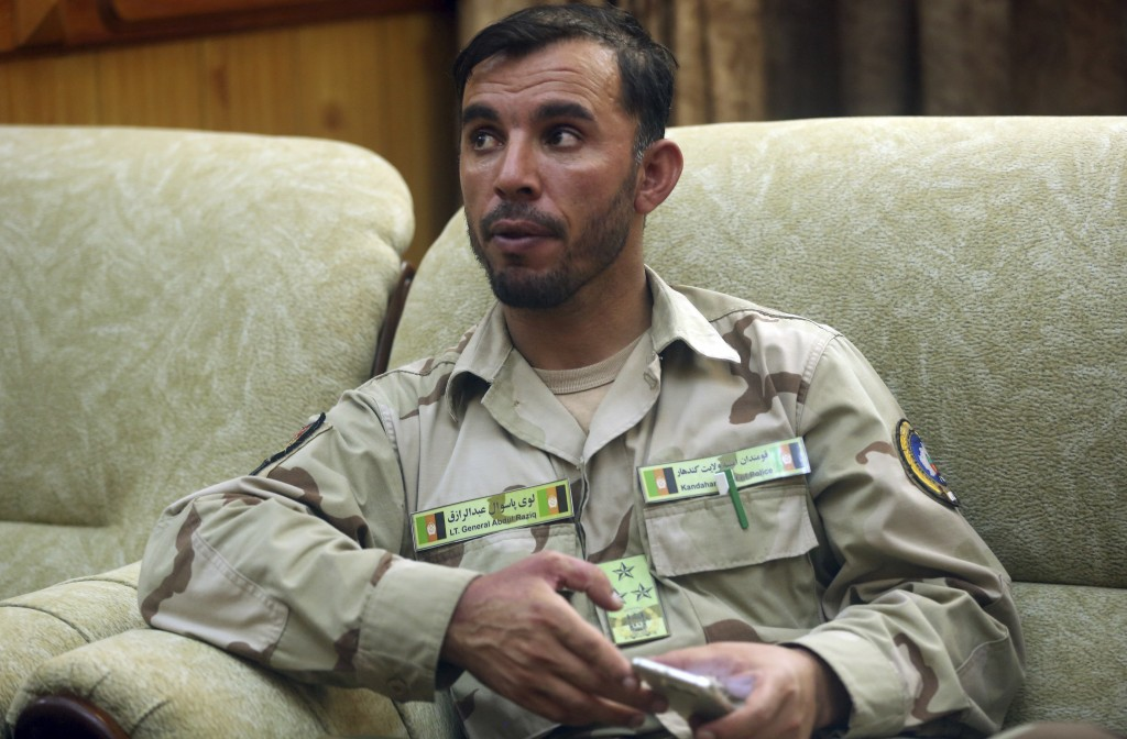 FILE - In this Aug. 4, 2016 file photo, Gen. Abdul Raziq, Kandahar police chief, speaks during an interview with The Associated Press in Kandahar, Afg...