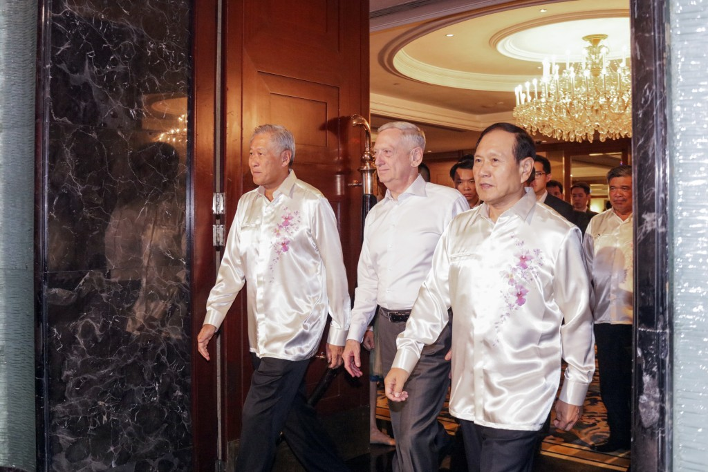 FILE - In this Oct. 19, 2018, file photo, U.S. Defense Secretary Jim Mattis, left, and Chinese Defense Minister Wei Fenghe attend a gala dinner at the
