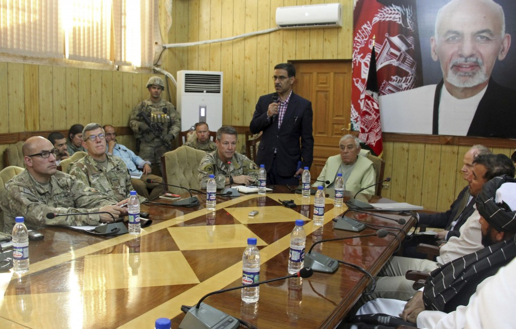 The head of NATO troops in Afghanistan, Gen. Scott Miller, center left, Kandahar Gov. Zalmay Wesa, center right, and their delegations attend a securi...