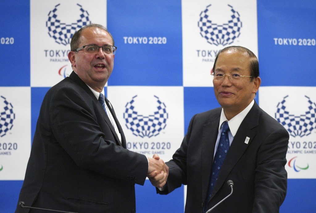 Xavier Gonzalez, left, CEO of the International Paralympic Committee (IPC), and Toshiro Muto, right, CEO of the Tokyo Organizing Committee of the Olym...