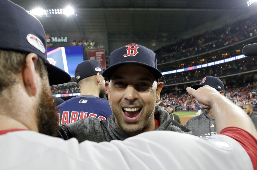 Boston Red Sox manager Alex Cora celebrates after they won the baseball American League Championship Series against the Houston Astros on Thursday, Oc