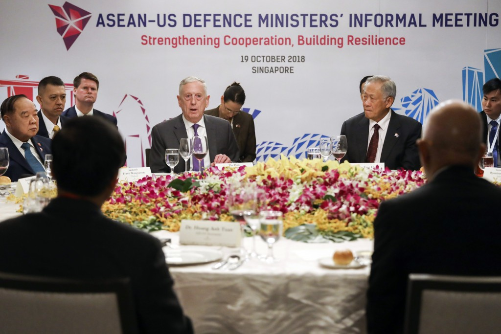 FILE - In this Oct. 19, 2018, file photo, from left, Thailand's Defense Minister Gen.  Prawit Wongsuwon, U.S. Defense Secretary Jim Mattis and Singapo