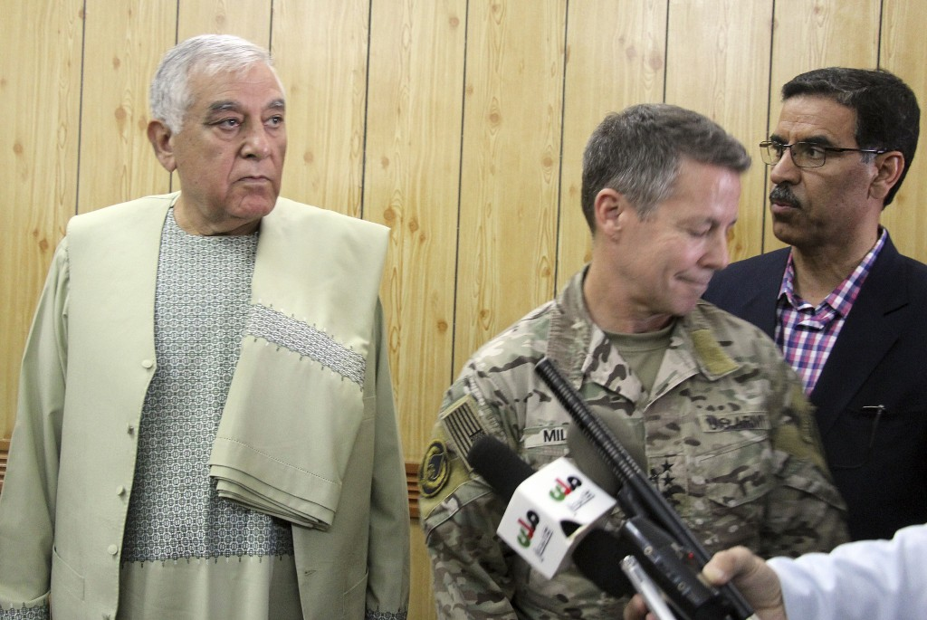 Kandahar Gov. Zalmay Wesa, left, stands with the head of NATO troops in Afghanistan, Gen. Scott Miller, center, and a translator, during a meeting, in...