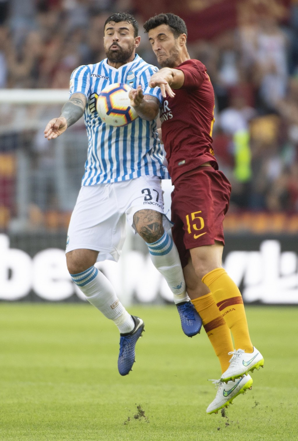 Spal's Andrea Petagna, left, vies for the ball with Roma's Ivan Marcano during the Italian Serie A soccer match between Roma and Spal, at Olimpico sta